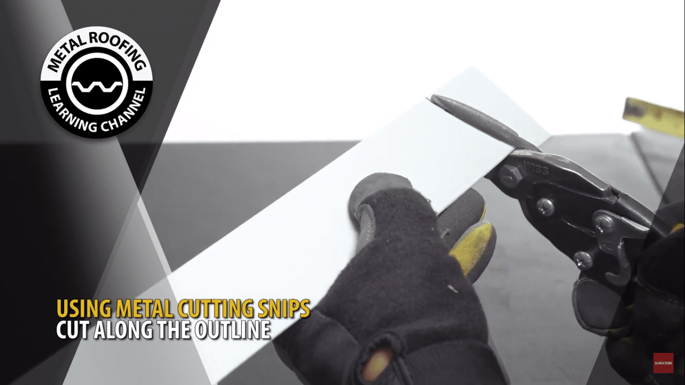 Using metal cutting snips cut along the outline